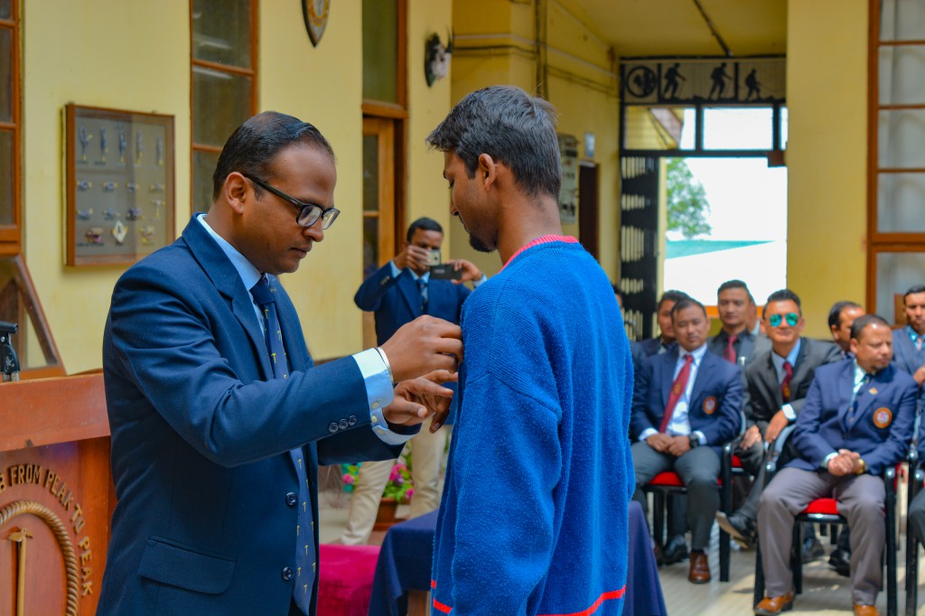 Receiving the honour from the Principal of HMI Darjeeling