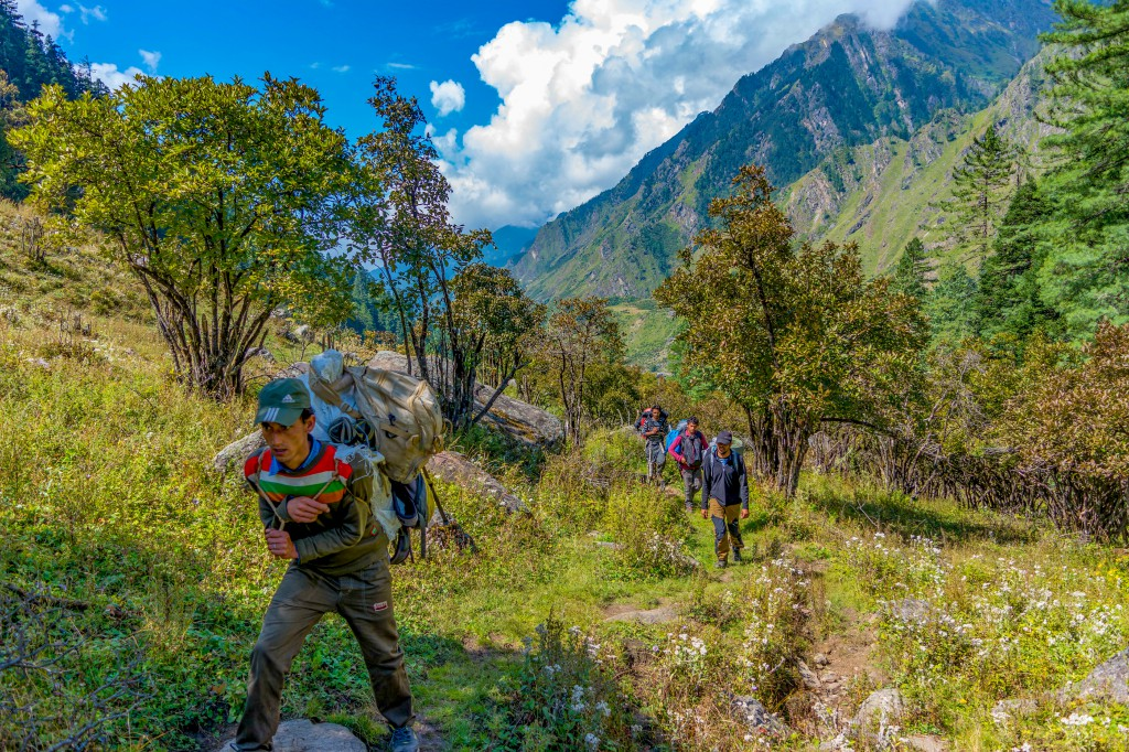 Porters crossing approaching towards Rainbasera campsite - Bali Pass Trek