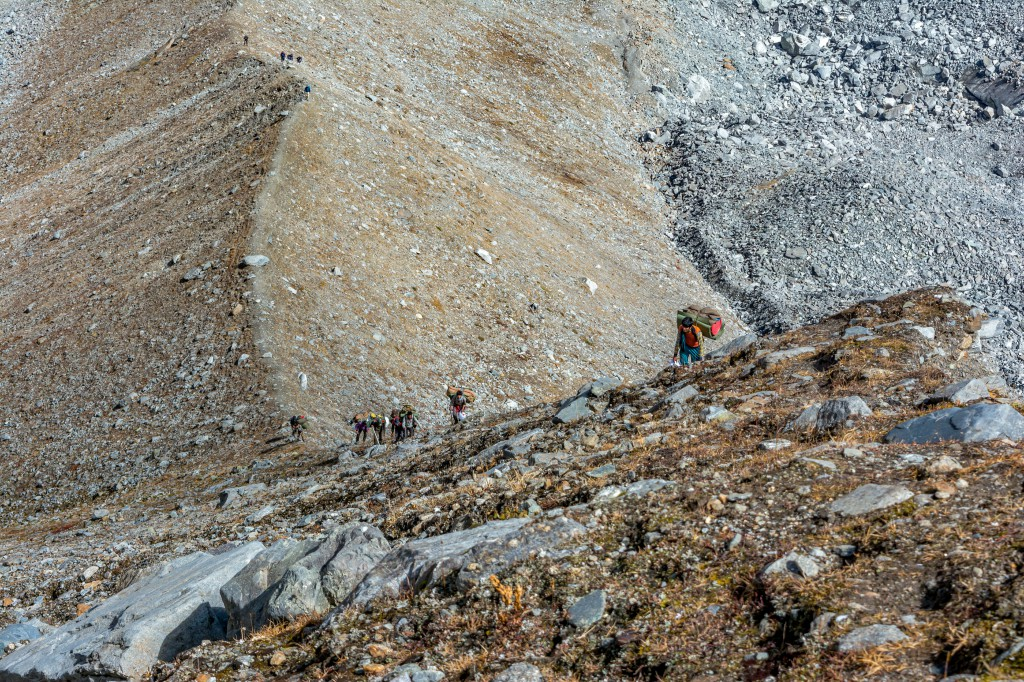 Climbing the steep ridge while approaching towards base camp - Bali Pass Trek