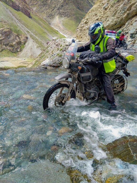 biker crossing a stream near Dercha - Ladakh Road Trip
