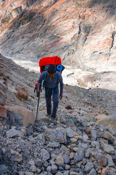 Trekking through a steep patch full of scree and boulders